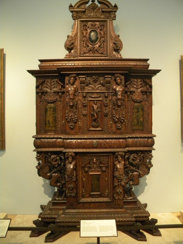 intricately designed wood armoire