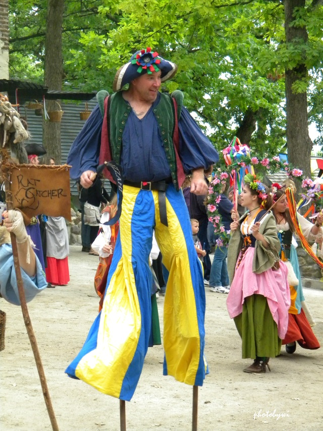 stilt walker, renaissance faire, bristol