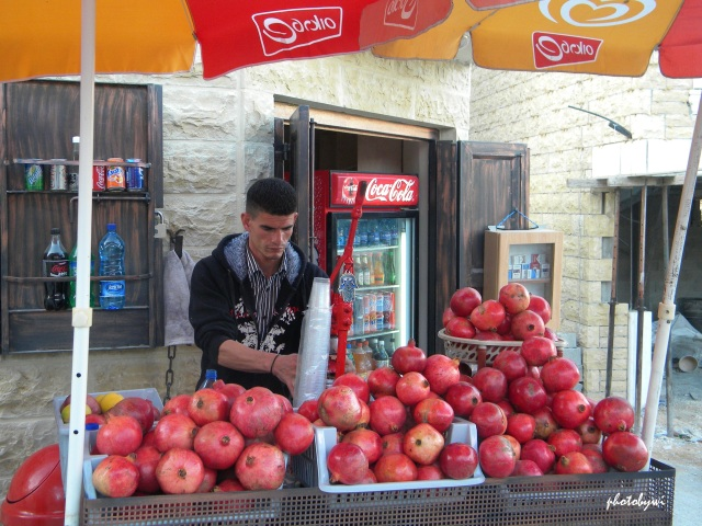 pink pomegranate vendor in nazareth
