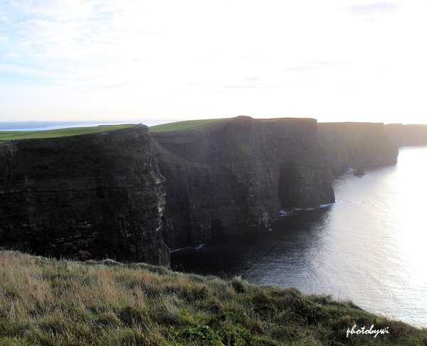 rugged cliffs of moher from a distance. county clare, ireland