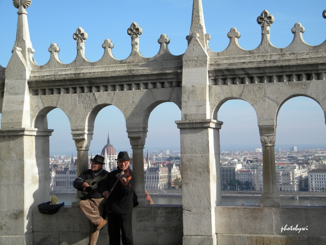 a duo playing guitar and violin at the fisherman's bastion in budapest