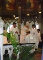 laying on of hands and prayer of consecration